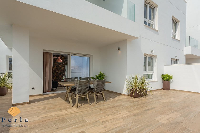 Stunning new apartment with garden in Punta Prima - Perla Investments